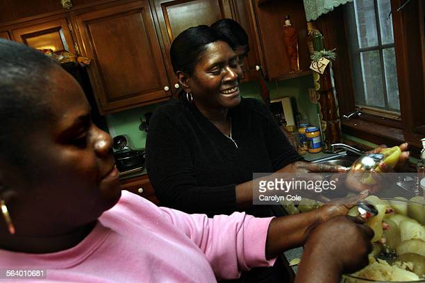 Patricia Edwards cooks on Christmas eve with her sister Evelyn Brooksm on Christmas eve. Some 40 members of Patricia's family came to Lancaster, PA,...