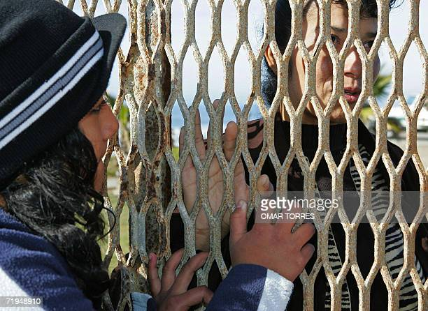 Patricia Escobar talks to her daughter Rosa Isela behind the fence between the Mexican and the US side in Tijuana Baja California state Mexico 29...