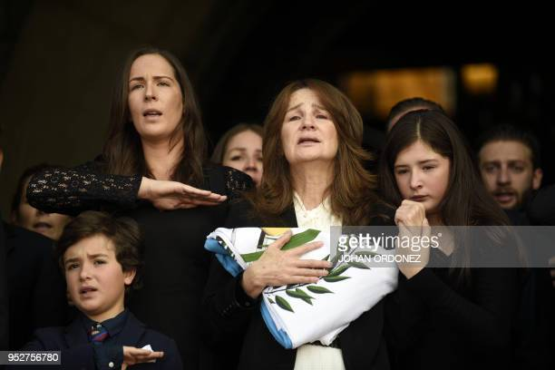 Patricia Escobar widow of former Guatemalan President and Guatemala City Mayor Alvaro Arzu next to their relatives grieve during his funeral at...
