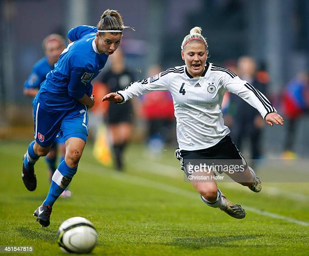 Patricia Fischerova of Slovakia tackles Leonie Maier of Germany during the FIFA Women's World Cup 2015 Qualifier between Slovakia and Germany at...