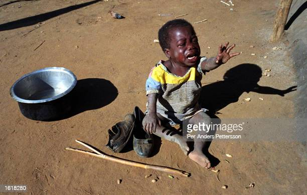 Patricia Frank cries from hunger June 11, 2002 in the village of Zuwala in the Salima district of Malawi. Salima district is one of the worst...