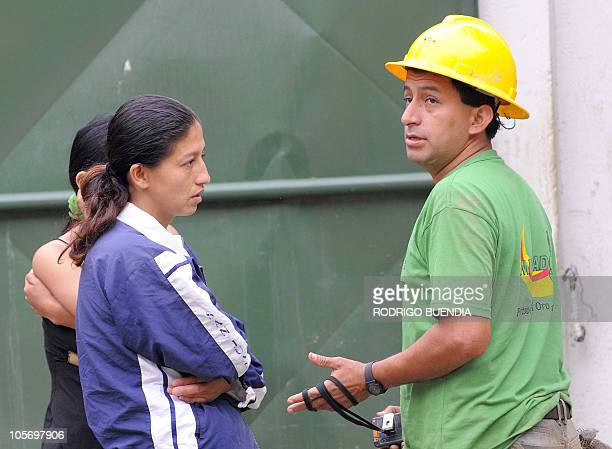 Patricia Gallegos wife of one of the trapped miners believed to still be alive asks for information from a worker outside of the Casa Negra mine in...