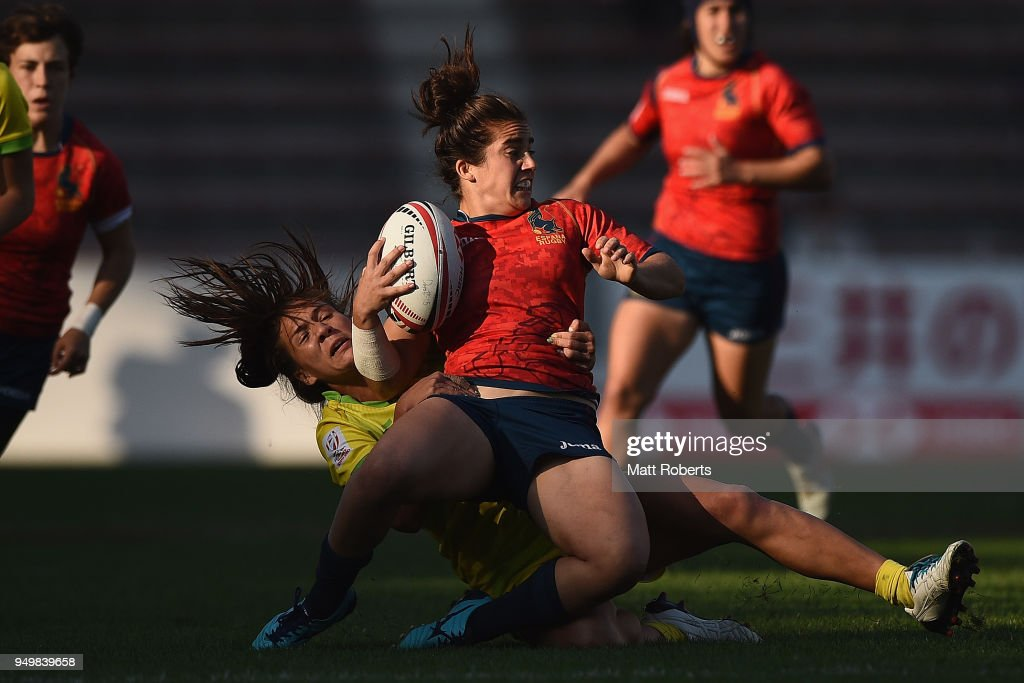 Patricia Garcia of Spain is tackled during the bronze medal match between Australia and Spain on day two of the HSBC Women's Rugby Sevens Kitakyushu at Mikuni World Stadium Kitakyushu on April 22, 2018 in Kitakyushu, Fukuoka, Japan.