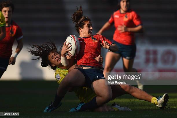 Patricia Garcia of Spain is tackled during the bronze medal match between Australia and Spain on day two of the HSBC Women's Rugby Sevens Kitakyushu...