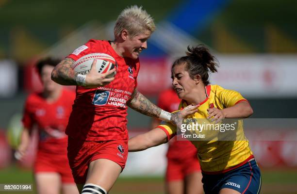 Patricia Garcia of Spain tackles Jennifer Kish of Canada during the match between Canada and Spain on Day One of the Emirates Dubai Rugby Sevens HSBC...