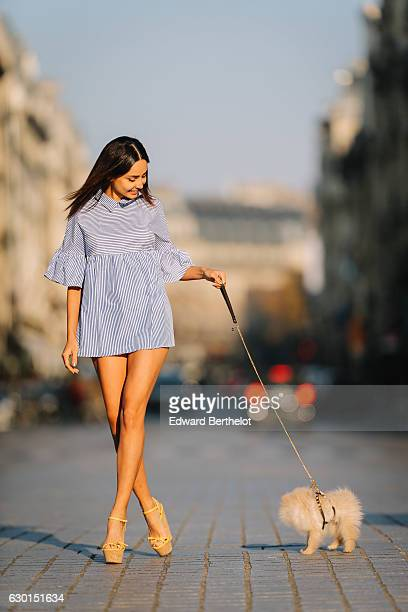 Patricia Gloria Contreras model and fashion blogger is wearing a Shein blue and white striped dress Dsquared shoes and is seen at Place Vendome with...