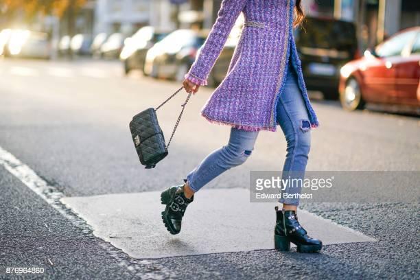 Patricia Gloria Contreras wears a Chanel tweed pink purple coat HM boots a Dior bag Dolce Gabbana blue denim jeans at avenue Montaigne on November 19...