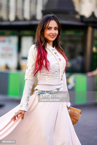 Patricia Gloria Contreras wears a pale pink dress with embroidered flowers outside Fendi during Paris Fashion Week Haute Couture Fall Winter...