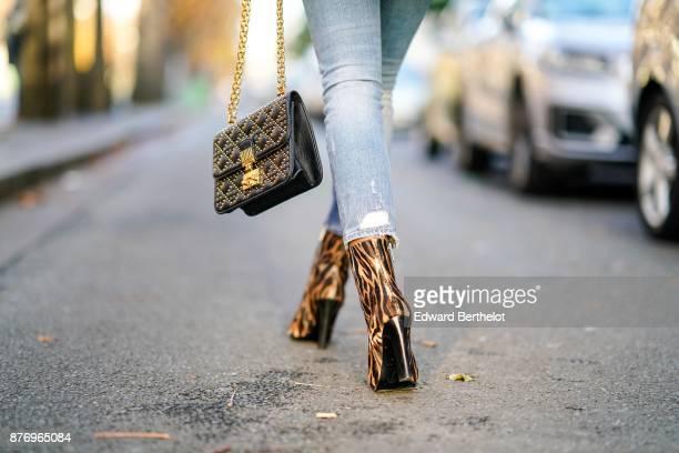 Patricia Gloria Contreras wears a white fur coat Dolce Gabbana blue denim jeans Jimmy Choo snake print leather shoes a Dior bag a white turtleneck...