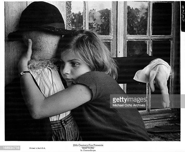 Patricia Gozzi hugging a scarecrow in a scene from the film 'Rapture' 1965