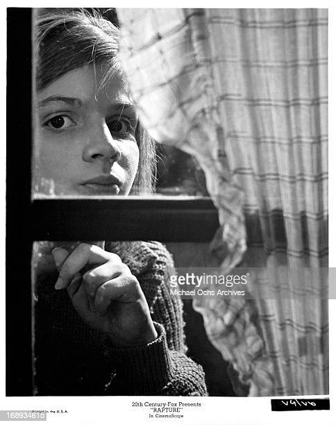 Patricia Gozzi peering out the window in a scene from the film 'Rapture' 1965