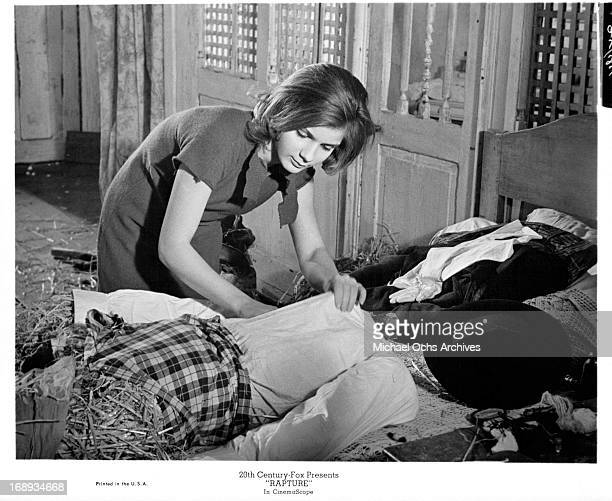 Patricia Gozzi stuffs a scarecrow in a scene from the film 'Rapture' 1965