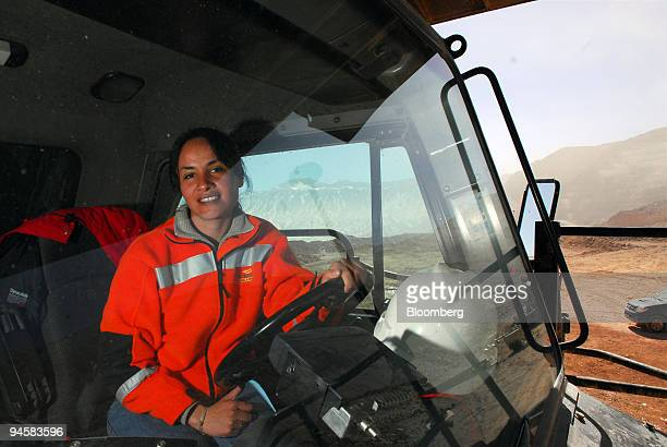 Patricia Guajardo sits in the mining truck she drives at Barrick Gold Corp's Veladero mine in the San Juan province of Argentina on Tuesday Oct 16...