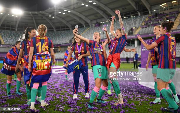 Patricia Guijarro of FC Barcelona celebrates with teammates after victory in the UEFA Women's Champions League Final match between Chelsea FC and...