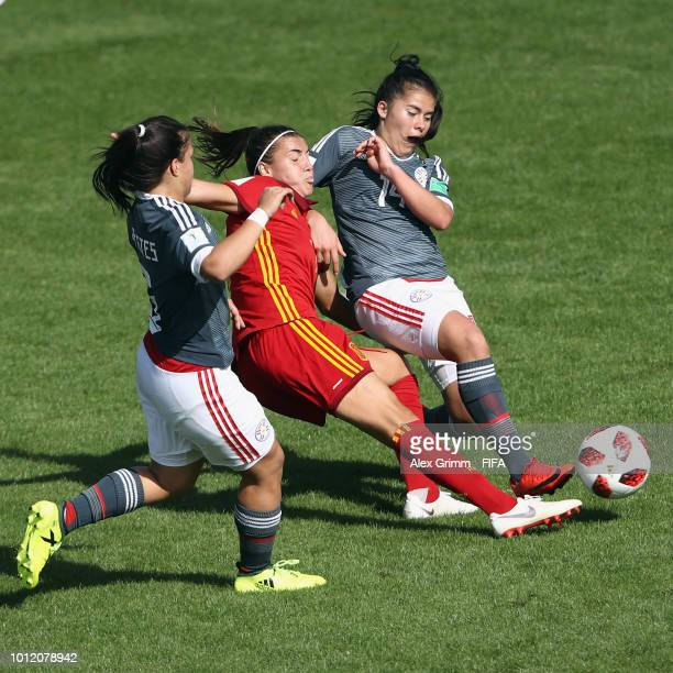 Patricia Guijarro of Spain is challenged by Limpia Fretes and Natalia Villasanti of Paraguay during the FIFA U-20 Women's World Cup France 2018 group...