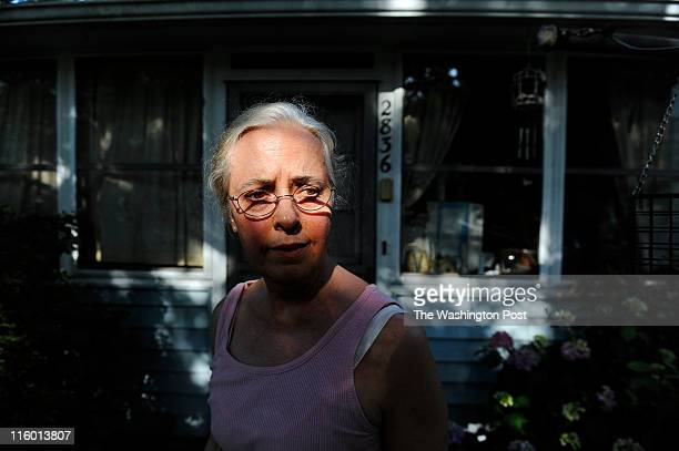 Patricia Hickerson stands outside the backdoor of her home in Hillwood Square where she has lived for over 61 years on June 08 2011 in Falls Church...