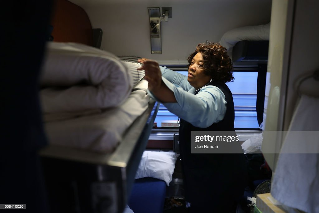 Patricia Johnson makes up a bed in one of the rooms in a sleeper car as Amtrak's California Zephyr rolls through the countryside during its daily 2,438-mile trip to Emeryville/San Francisco from Chicago that takes roughly 52 hours on March 25, 2017 in Truckee, United States. President Trump has proposed a national budget that would terminate federal support for Amtrak's long distance train services, which would affect the California Zephyr and other long distance rail lines run by Amtrak.
