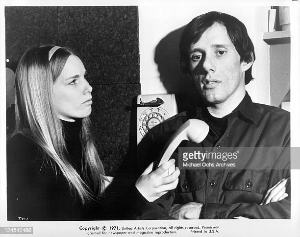 Patricia Joyce handing the phone to James Woods in a scene from the film 'The Vistors' 1972