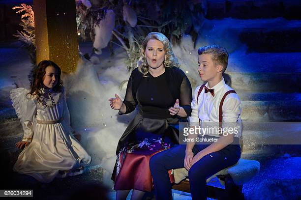 Patricia Kelly and Iggi Kelly are seen on stage during the tv show 'Das Adventsfest der 100000 Lichter' on November 26 2016 in Suhl Germany