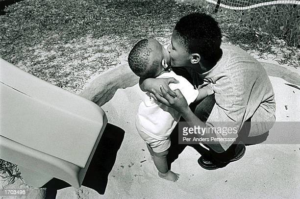 Patricia Lincoln, 16-years-old, comforts her one-year-old daughter, Baby Thsepang, at the playground of the Red Cross Children?s Hospital February...