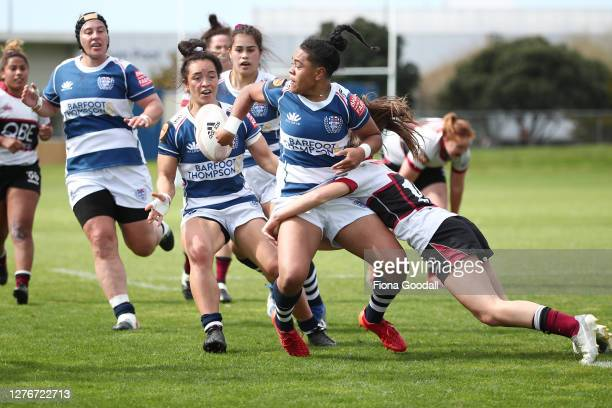 Patricia Maliepo of Auckland offloads to Theresa Fitzpatrick of Auckland during the round 4 Farah Palmer Cup match between North Harbour and Auckland...