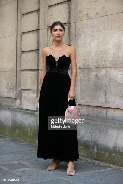Patricia Manfield in a black dress and pink purse outside Valentino couture on July 4 2018 in Paris France