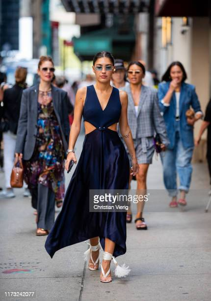 Patricia Manfield is seen wearing navy dress outside Tibi during New York Fashion Week September 2019 on September 08 2019 in New York City