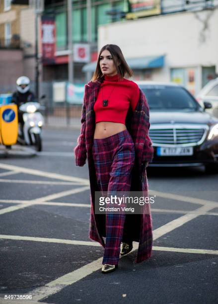 Patricia Manfield wearing checked pants and coat red cropped top outside Tommy Hilfiger during London Fashion Week September 2017 on September 19...