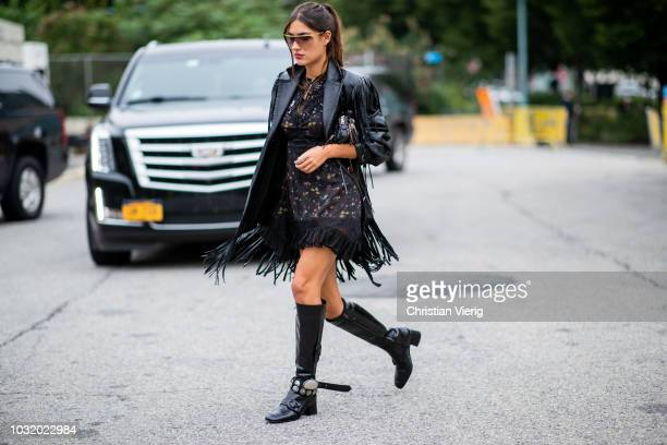 Patricia Manfield wearing dress black leather jacket boots seen outside Coach during New York Fashion Week Spring/Summer 2019 on September 11 2018 in...