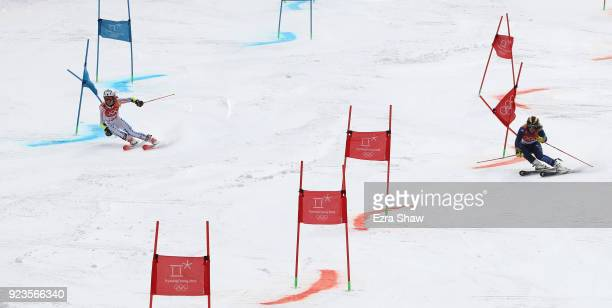 Patricia Mangan of the United States and Alex Tilley of Great Britain compete during the Alpine Team Event 1/8 Finals on day 15 of the PyeongChang...