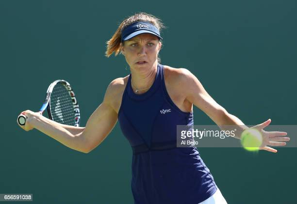 Patricia Maria Tig of Romania in action against Heather Watson of Great Britain during day 3 of the Miami Open at Crandon Park Tennis Center on March...