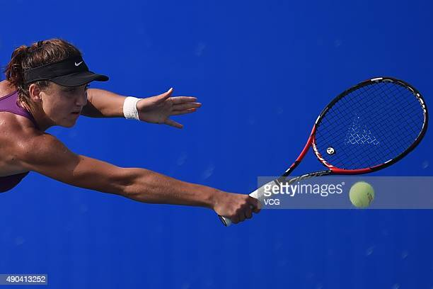 Patricia Maria Tig of Romania returns a shot against Kristina Mladenovic of France during day two of the 2015 Wuhan Open at Optics Vally...