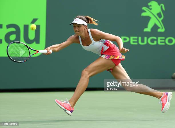 Patricia Maria Tig of Romania returns a shot against Venus Williams during Day 7 of the Miami Open at Crandon Park Tennis Center on March 26 2017 in...