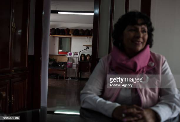 Patricia Marin Mesa poses who was diagnosed with an aggressive type of breast cancer poses for a picture in Bogota Colombia on November 29 2017 For...