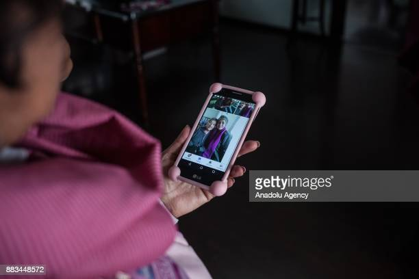 Patricia Marin Mesa showing pictures at her phone about her process with the cancer in Bogota Colombia on November 29 2017 For many women undergoing...