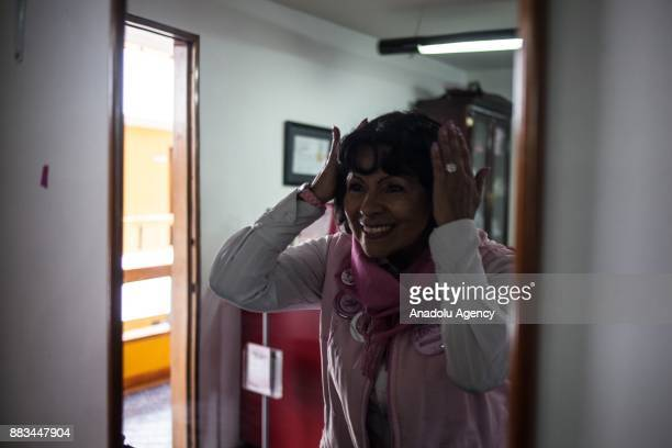 Patricia Marin Mesa smiling from of the mirror in Bogota Colombia on November 29 2017 Patricia is a cancer survivor now she is a volunteer to the...
