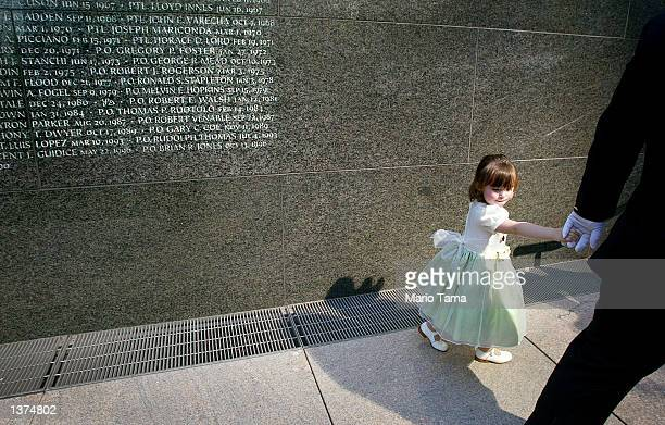 Patricia Mary Smith, daughter of NYPD officer Moira Smith, who was killed in the September 11th terrorist attacks, walks past the police memorial...
