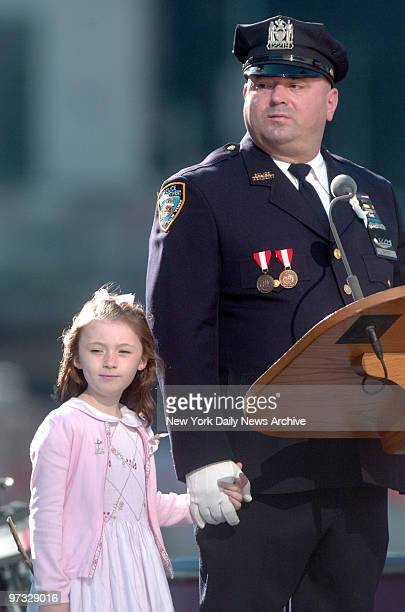 Patricia Mary Smith holds hands with her father, Office James Smith, during a memorial service to commemorate the fifth anniversary of the Sept. 11...