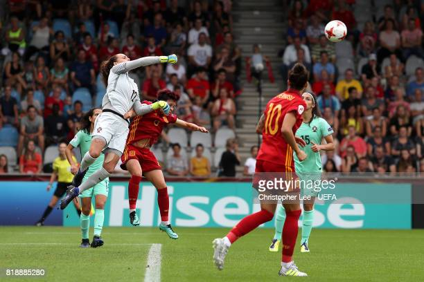 Patricia Morais of Portugal punches the ball clear from the incoming challenge from Amanda Sampedro of Spain during the UEFA Women's Euro 2017 Group...