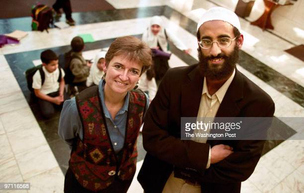 Patricia Morris and Imam Anwar Al Awlaki photographed inside Dar al Hijrah Mosque in Falls Church VA In background are students at the Islamic School...
