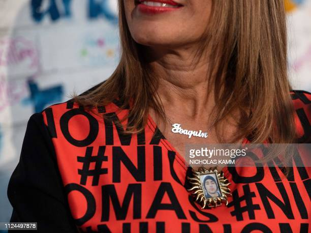 Patricia Oliver whose son Joaquin Oliver was killed in the Stoneman Douglas High School shooting wears a medallion with a picture of Joaquin and a...