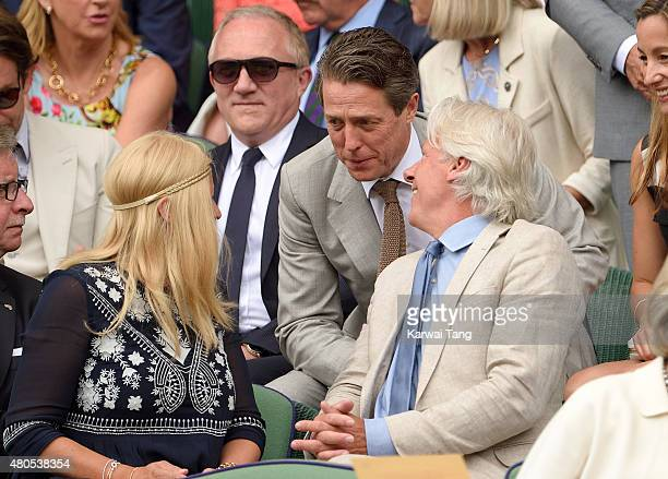Patricia Ostfeldt Hugh Grant and Bjorn Borg attend day 13 of the Wimbledon Tennis Championships at Wimbledon on July 12 2015 in London England