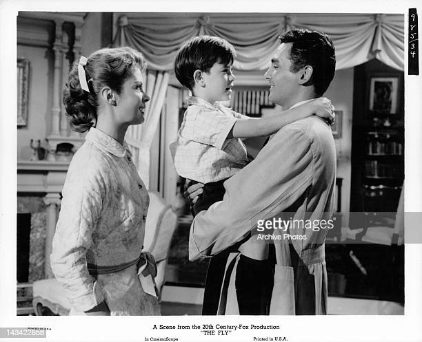 Patricia Owens Charles Herbert and David Hedison having happy family get gathering in a scene from the film 'The Fly' 1958