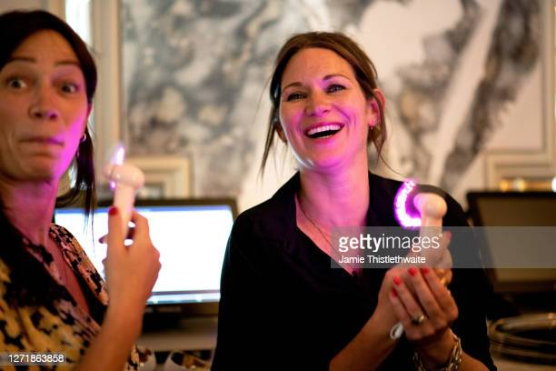 """Patricia Potter fans herself with a neon mini fan during the """"Henpire"""" podcast launch event at Langham Hotel on September 10, 2020 in London, England."""