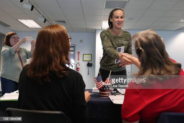Patricia Racz looks on as her daughter Erica Racz registers to vote at the Lee County Supervisor of Elections office on January 08 2019 in Fort Myers...