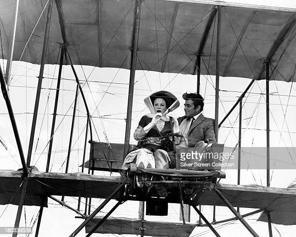Patricia Rawnsley takes a flight with Orvil Newton in his 'Phoenix Flyer' in 'Those Magnificent Men In Their Flying Machines' directed by Ken Annakin...