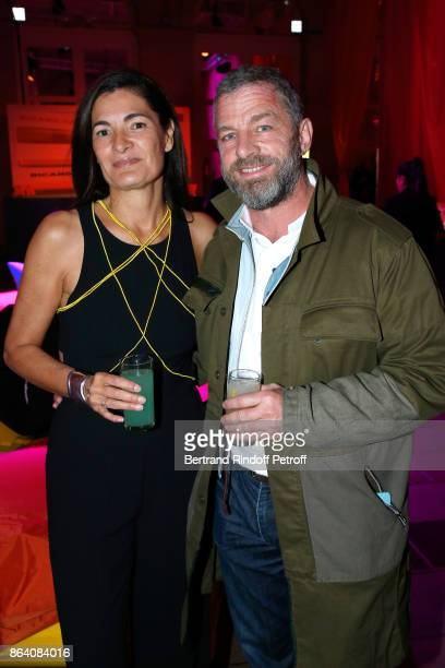 Patricia Ricard and CEO of Courreges Jacques Bungert attend the 'Bal Jaune Elastique 2017' Dinner Party at Palais Brongniart during FIAC on October...