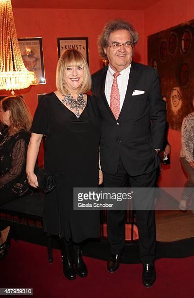 Patricia Riekel and her partner Helmut Markwort attend the 'Alle Sieben Wellen' Premiere at Komoedie on October 27 2014 in Munich Germany