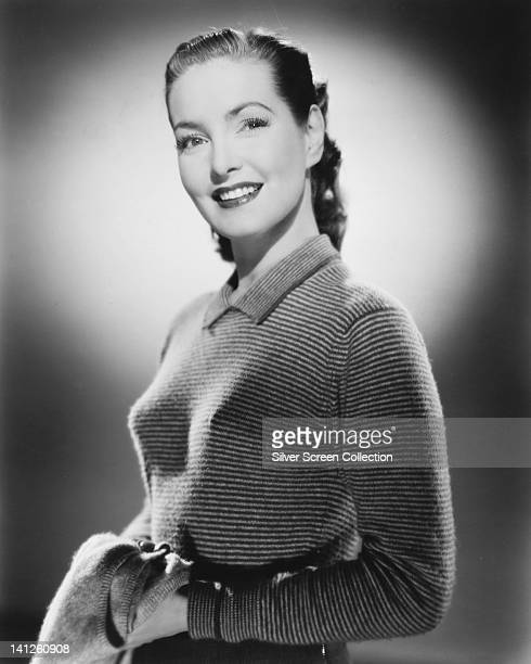 Patricia Roc British actress wearing a long sleeve top with horizontal stripes smiling in a studio portrait circa 1945