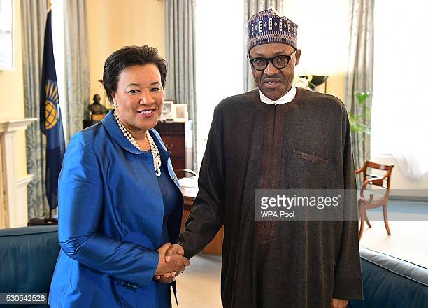 Patricia Scotland secretarygeneral of the Commonwealth meets with Nigerian President Muhammadu Buhari on arrival at Marlborough house prior to the...